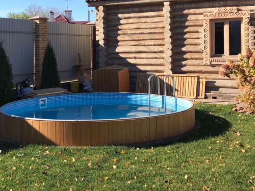 Круглый сборно каркасный бассейн, светлое дерево открытый монтаж